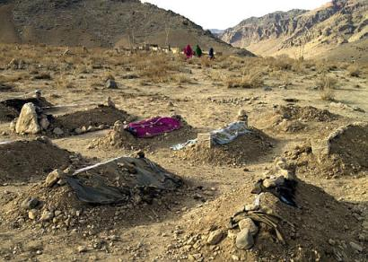 Graves of nine children killed by US air strike.