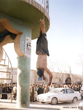 Afghan police hang killed victims in the Farah City in western Afghanistan