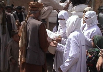 RAWA members distribute flour to refugees