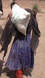 A refugee woman who just received aid from RAWA