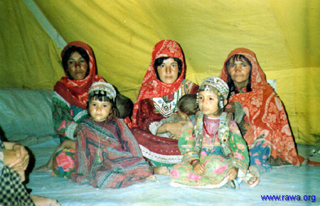 Displaced women in their tent