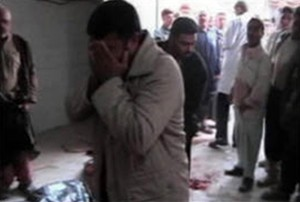 photo from Iran's Alalam News shows relatives mourning the dead
