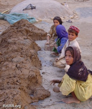 Afghan children in brick-making factories