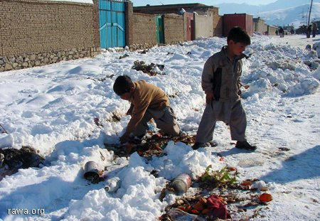 Children looking for food under snowfall