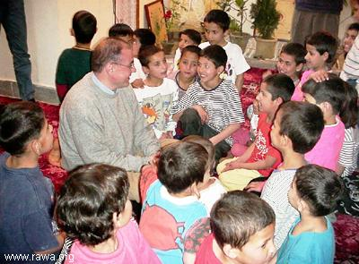 Mr. Javier Madrazo Lavín a minister of Basque Government talking with a group of orphans