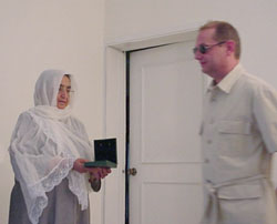 Mr. Jean Berthault awards the medal to Mother Zemaray, a bereaved woman whose eight sons have been kidnapped and killed by terrorists of Hekmatyar gang