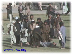 Taliban carry the dead body of the victim