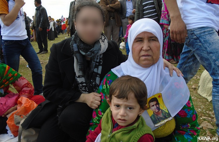 RAWA member with a woman who had recently lost her nephew in the Kobani conflict