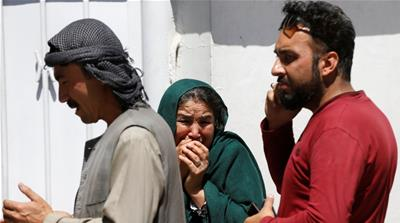 Wounded Afghan women seen at the site of a car bomb attack in June 2017 in Kabul