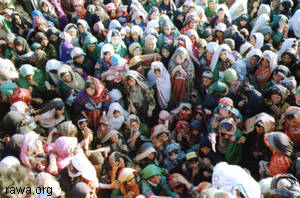Hundreds of women rush to receive food from RAWA
