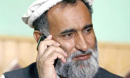 In this Sept. 18, 2010 photo, Abdul Ghafur speaks on the telephone in Jalalabad in Afghanistan's Nangarhar province.