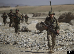 An Afghan Army soldier patrols Afghanistan's Logar Province