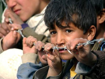 Afghan boy behind wire
