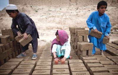 Afghan children in bricks factory