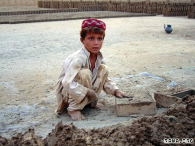 Afghan kids work in brick factories