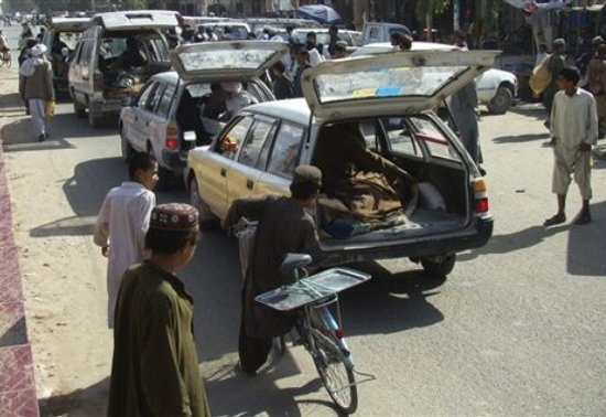 Cars carrying dead bodies as they arrive to Lashkar Gah
