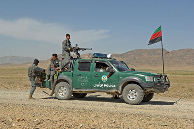 Afghan Highway Police officers participate in a joint patrol with U.S. Soldiers in Afghanistan, March 17, 2010