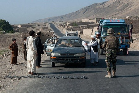 Afghan Local Police stop vehicles in the Alasai valley, Kapisa province