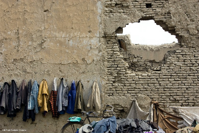 Afghan students coats hung on the wall at a school in Kabul
