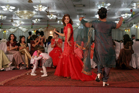 Women dance in Afghan wedding party