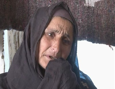Afghan woman cries