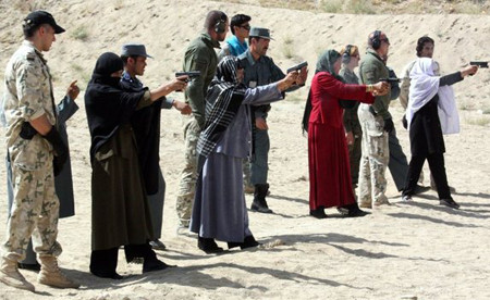 Afghan female police officers are trained by Afghan police and NATO soldiers in eastern Afghanistan's Ghazni province