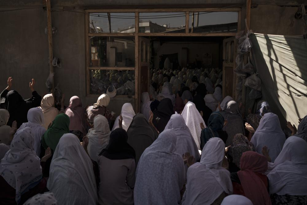 afghan women pray in a shiite mosque