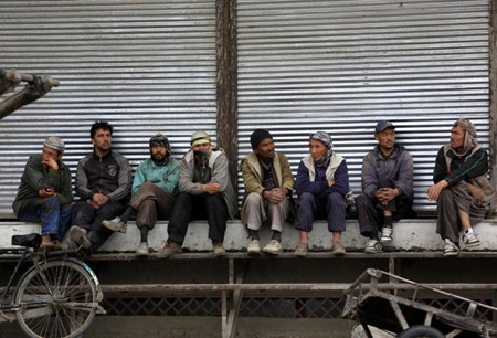 Afghan labor workers wait for customers in Kabul, Afghanistan