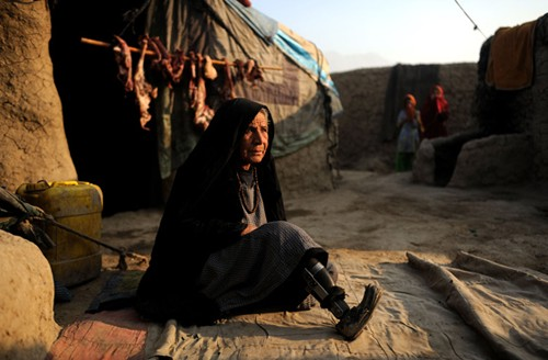 Legless Rabia, 70, living in a Kabul refugee camp whose husband and son were killed by NATO forces