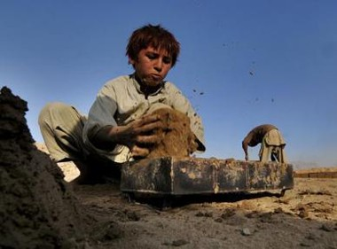 Afghan children work in Kabul