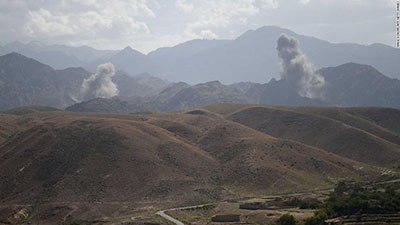 The aftermath of an air strike on insurgents in the eastern Afghan province of Nangarhar on July 8