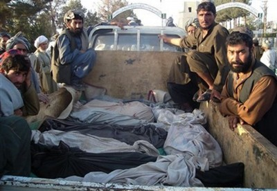 Dead bodies of Afghans, who were killed allegedly by allied airstrikes in Nad Ali district of Helmand province
