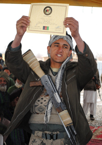 An Afghan Local Police graduate holds up a certificate in Imam Saheb, the second district in Kunduz to undertake local police training