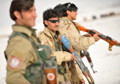 Afghan soldiers attack and hit civilians with rifle butts
