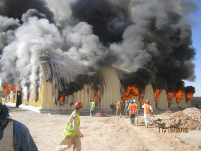 Fire consumes an arch-span building at Afghan National Army Brigade Camp Sayar in Afghanistan in 2012