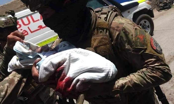 Security forces rescue a wounded baby