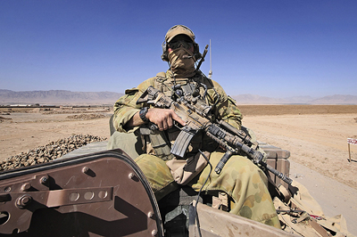 A soldier from the Special Operations Task Group during a convoy move through Tarin Kowt, Afghanistan