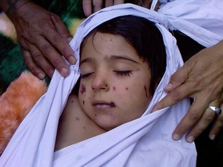 An Afghan child who was killed during a US- led raid in Azizabad