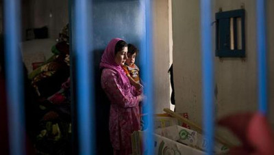 An Afghan female prisoner is seen with her child inside her prison tract in Badam Bagh, Afghanistan's central women's prison in Kabul