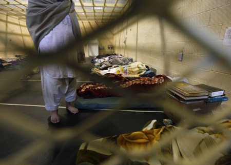 Afghan detainees are seen through mesh wire fence inside the detention facility near Bagram Air Base in Afghanistan