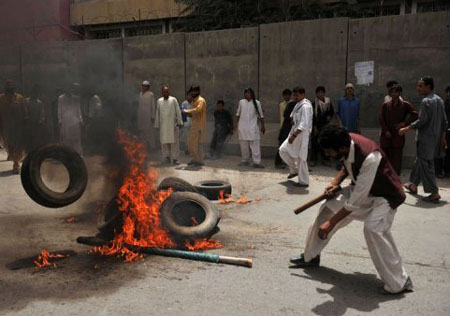 Protesters were seen carrying sticks and burning tyres