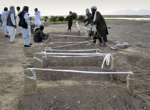 Afghan villagers mark new burial site of victims