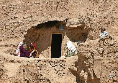 Family in cave in Bamyan