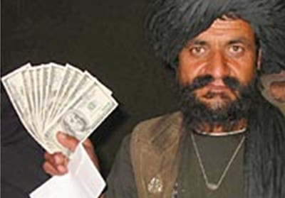 Bari Gul with his ten $100 bills