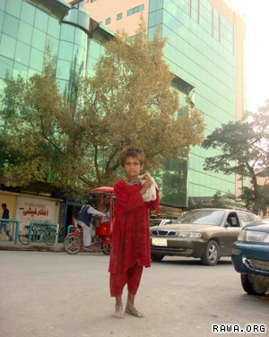 A girl begs in Kabul