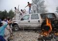 Angry Afghan Mob torches US embassy vehicles after deadly crash in Kabul