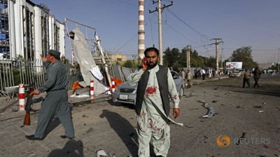 An Afghan man talks on his phone after a bomb blast in Kabul, Afghanistan August 22, 2015