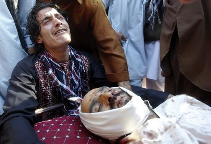 May 1, 2012: Ayoub Khan, mourns over body of his friend, Abdul Satar, who was allegedly killed in an Afghan-led operation in Laghman east of Kabul, Afghanistan