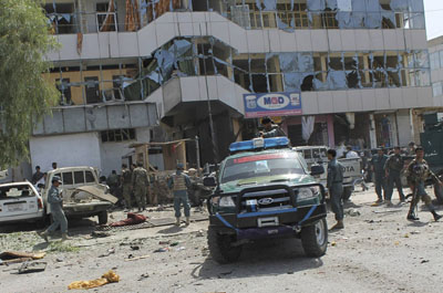 Along with the bank building, several small shops and vehicles were also damaged in the deadly attack