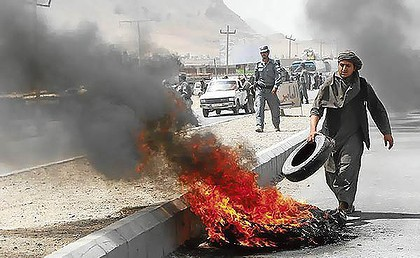Protestors burned tyres in protest against NATO in Kandahar.jpg